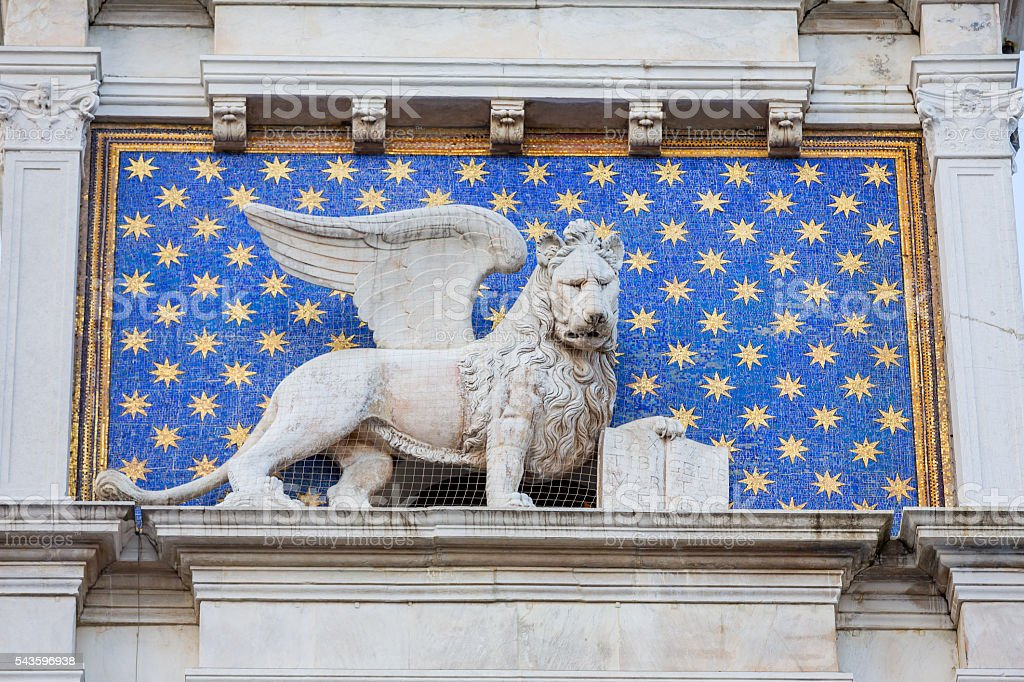 Lion close-up on St Mark's Clocktower in Venice stock photo