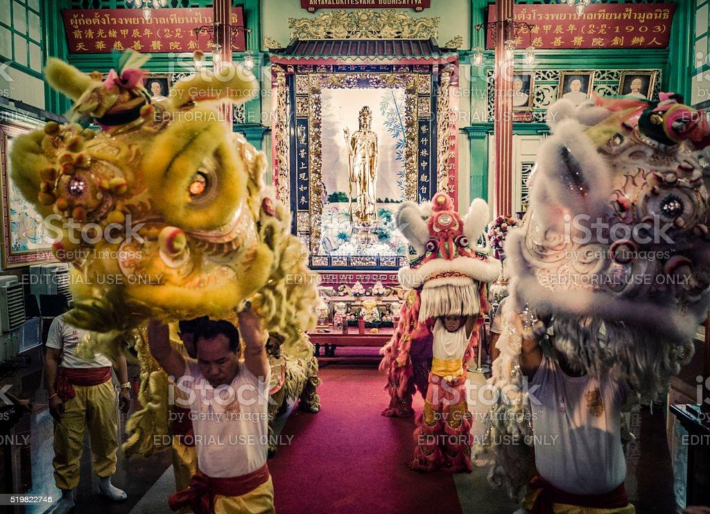 Lion dance at Guan Yin shrine Bangkok stock photo