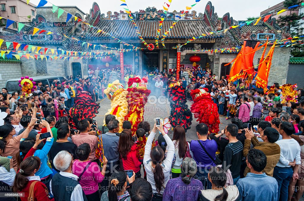 Lion dance in the ancestral temple stock photo