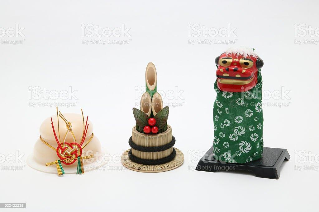 Lion dance(Shishimai), round rice cake(Kagamimochi), and bamboo(kadomatsu). stock photo