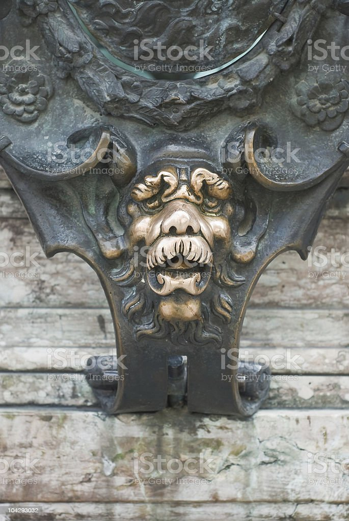 Lion Face on a Statue royalty-free stock photo
