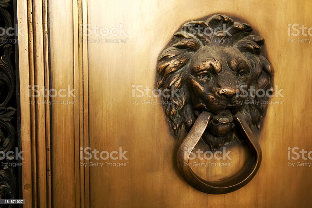 Lion Head Brass Knocker Horizonal with Door Frame stock photo