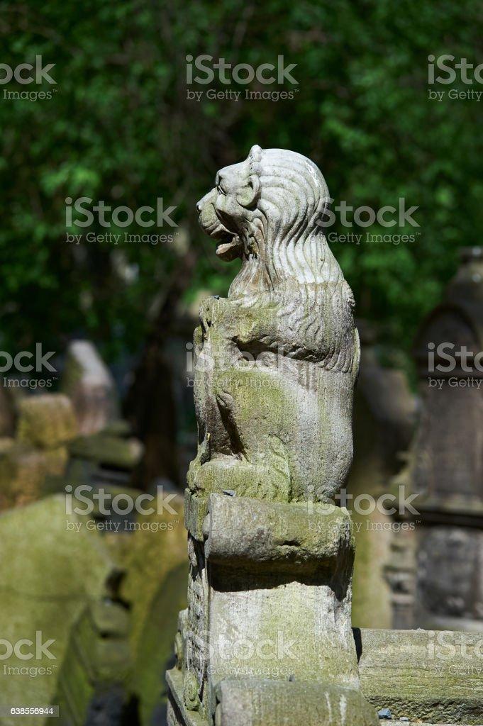 Lion herald on gravestone. Old Jewish Cemetery Prague. stock photo