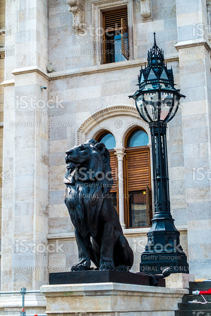lion monument parliament budapest hungary stock photo