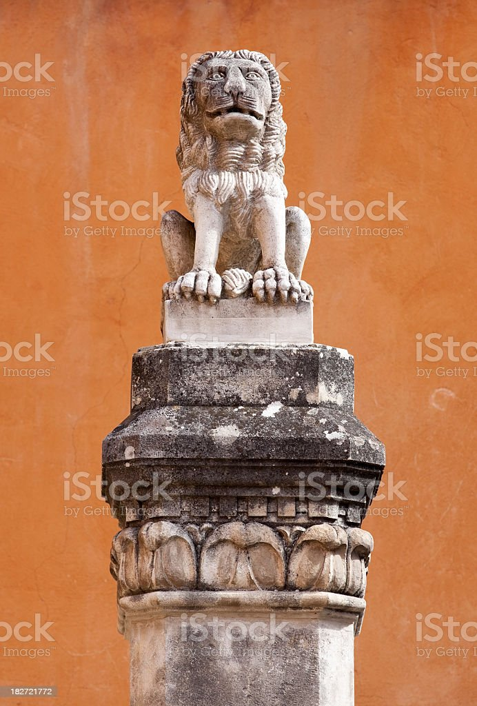 Lion sculpture on a pedestal stock photo