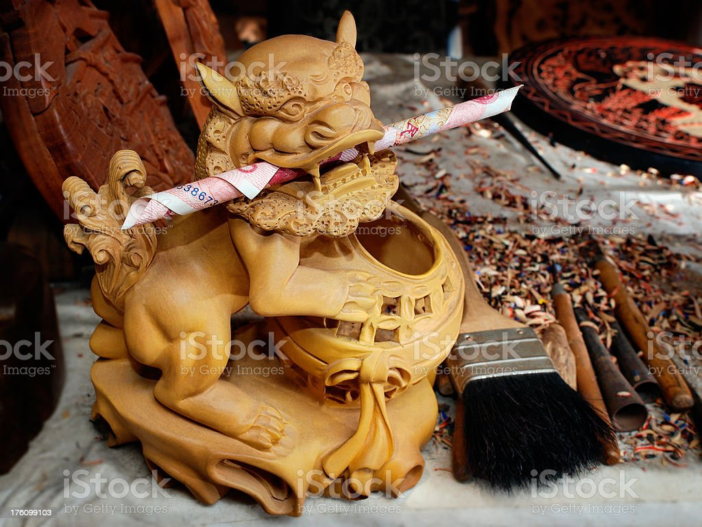 Lion Sculpture on a Wood Craftsman's Table royalty-free stock photo