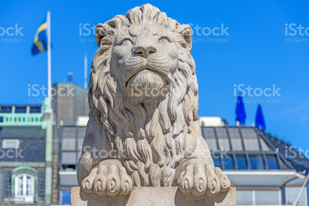 Lion sculpture on front Parliament of Norway stock photo