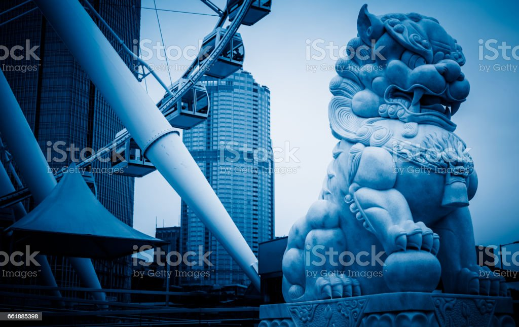 Lion statue in front of modern building stock photo