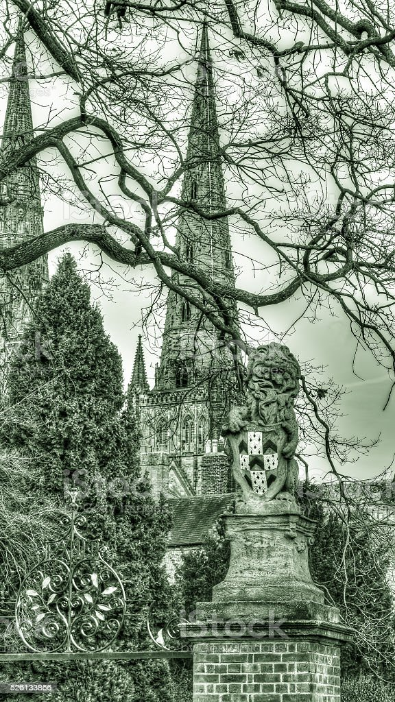 Lion statue with Lichfield cathedral HDR stock photo