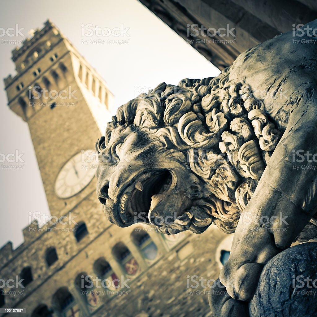 Lion Statue with Palazzo Vecchio in Firenze, Italy stock photo