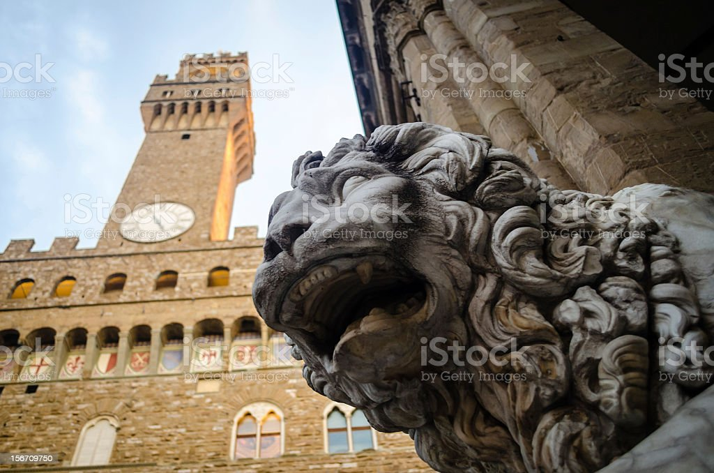 Lion Statue with Palazzo Vecchio in Florence, Italy stock photo
