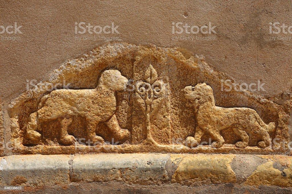 Lions and a fleur de lis sculpture. Tomar, Portugal. stock photo