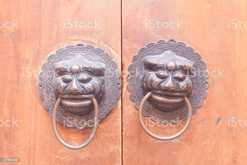 Lions Gate on the wood door. stock photo