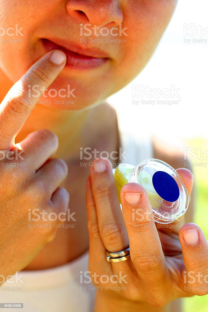 Lip Balm - Applying (Hi-Key) royalty-free stock photo