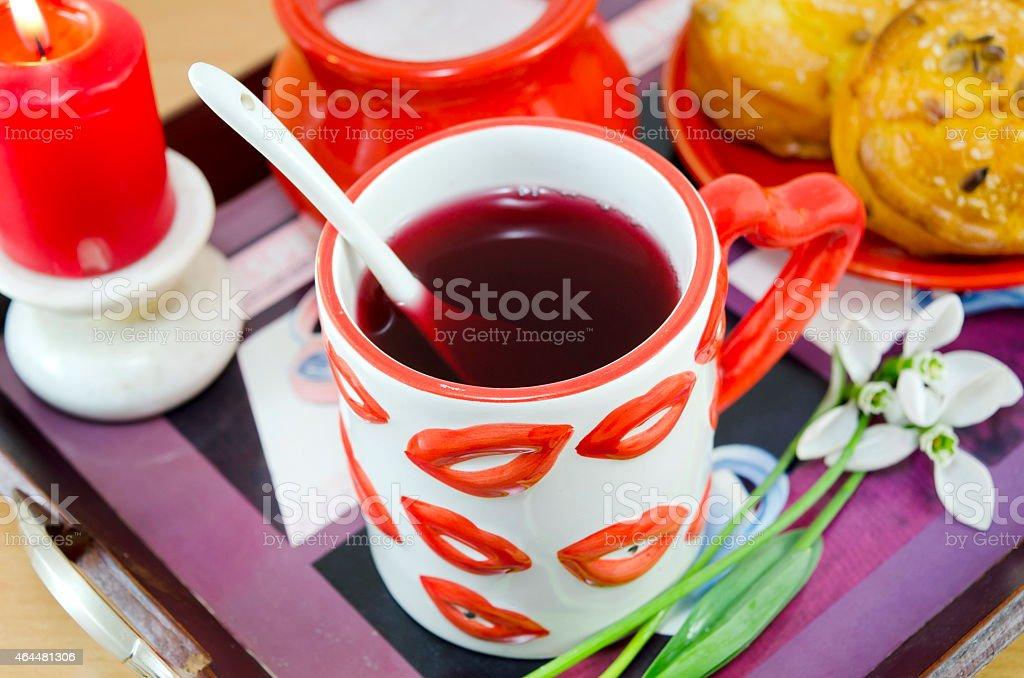 Lip patterned tea mug and corn bread closeup royalty-free stock photo