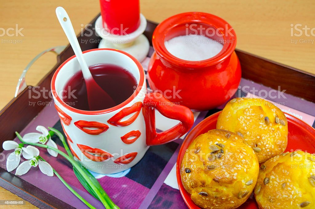 Lip patterned tea mug and corn bread royalty-free stock photo