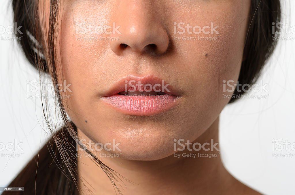 Lips and Nose of a Young Woman stock photo