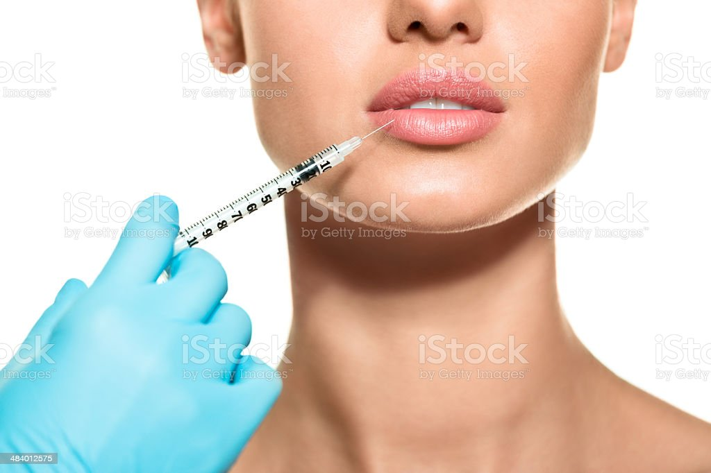 Lips augmentation stock photo