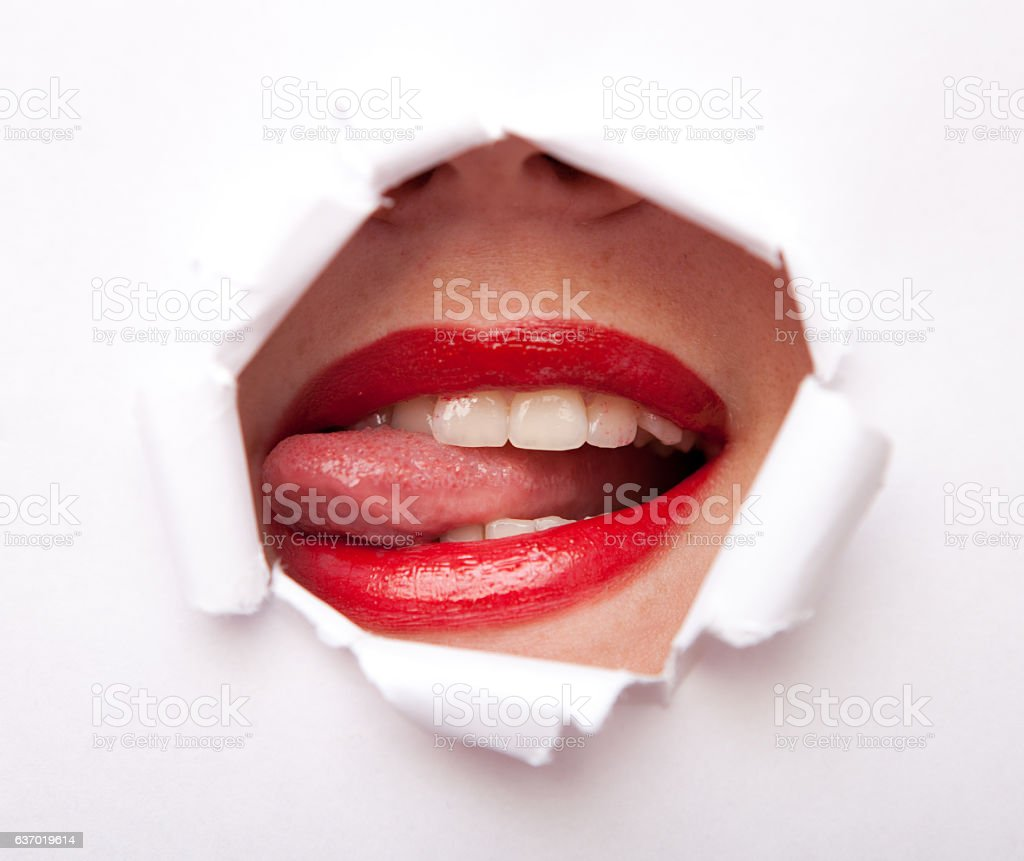 Lips from paper hole stock photo