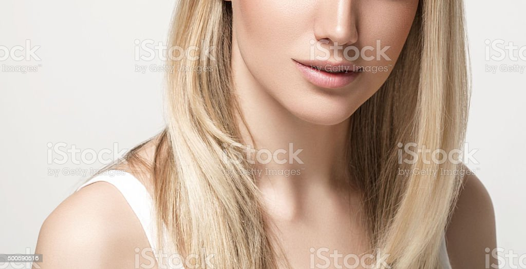 Lips Neck Shoulders Beautiful woman blonde close up studio white stock photo