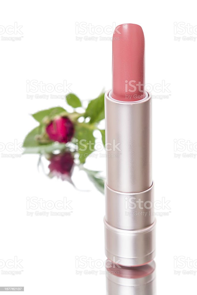 Lipstick and flower royalty-free stock photo