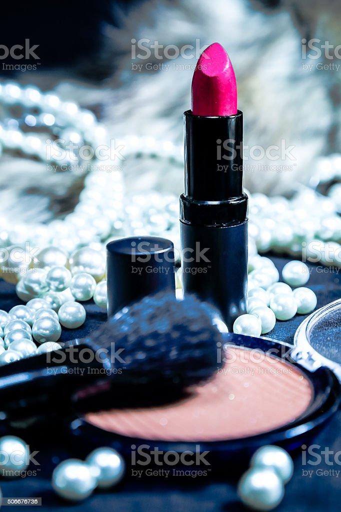 Lipstick, blush, perls and fur, glamour and luxury. stock photo
