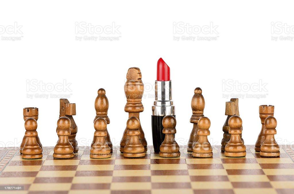 Lipstick commanding chess royalty-free stock photo