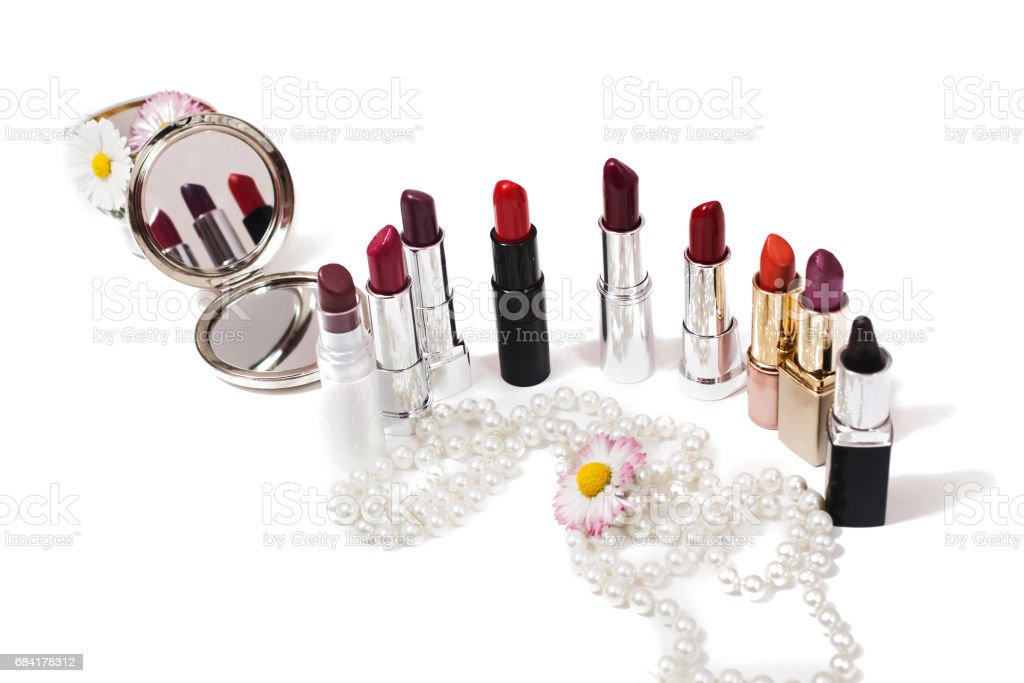 Lipstick isolated on white background. Female lip pencil. Kiss of lips on paper. The word love written in lipstick. Reflection of lipstick in the mirror. View from above. Concept. Decorative cosmetics stock photo