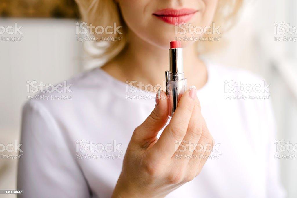 Lipstick to paint lips stock photo