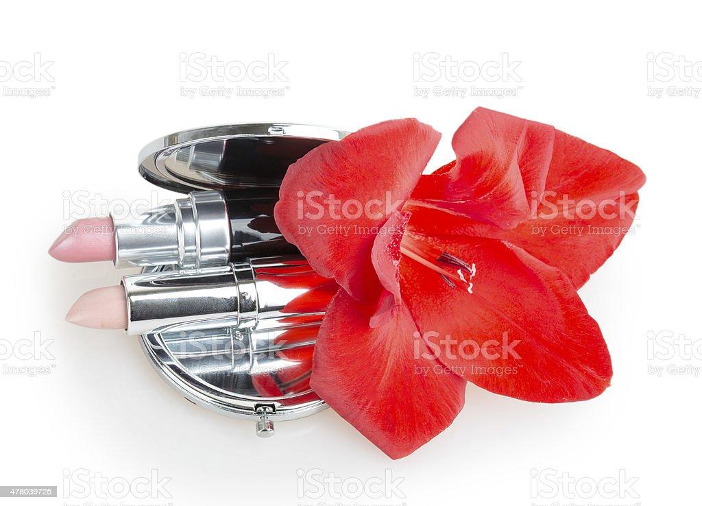 Lipstick with gladiolus flower royalty-free stock photo