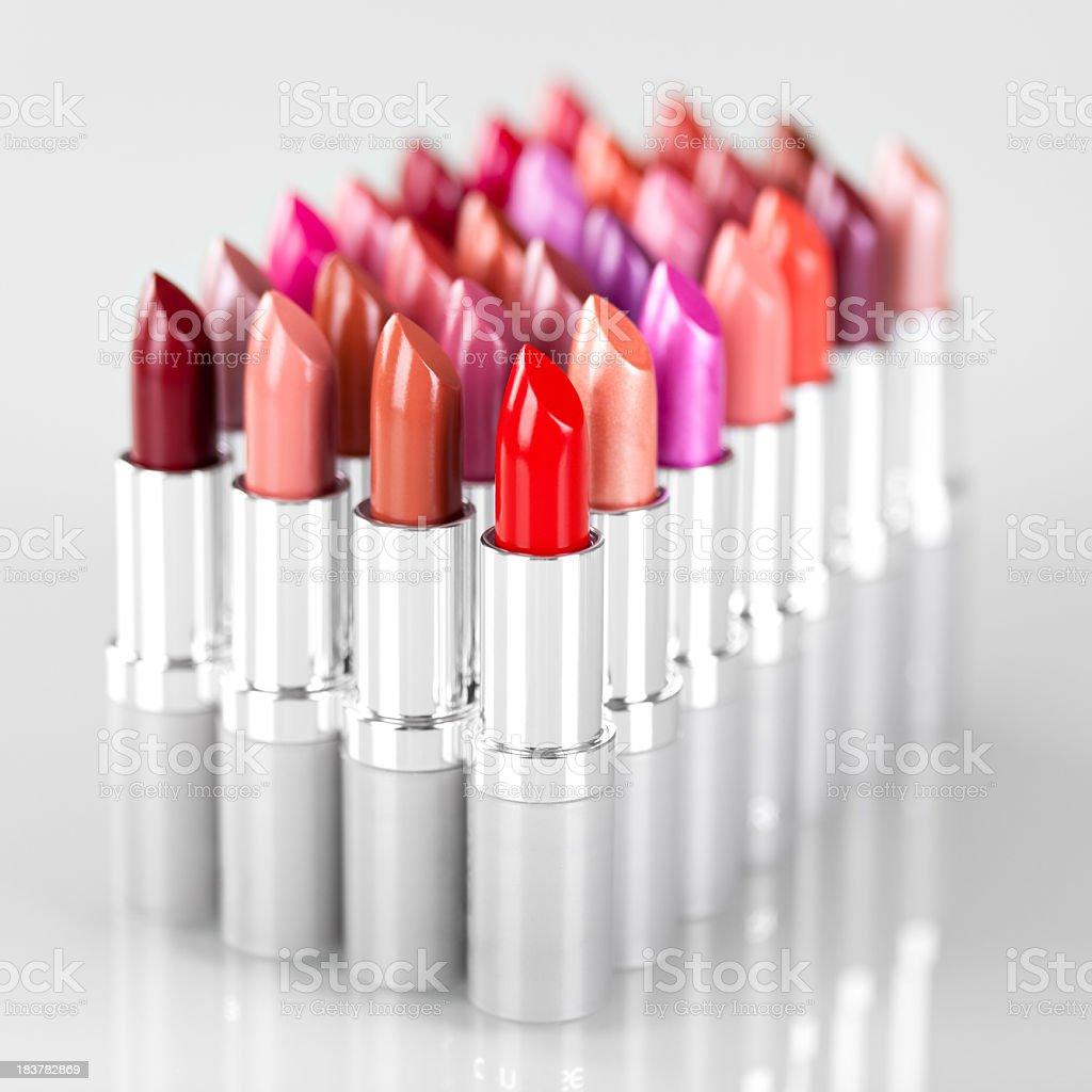 Lipsticks in a row stock photo