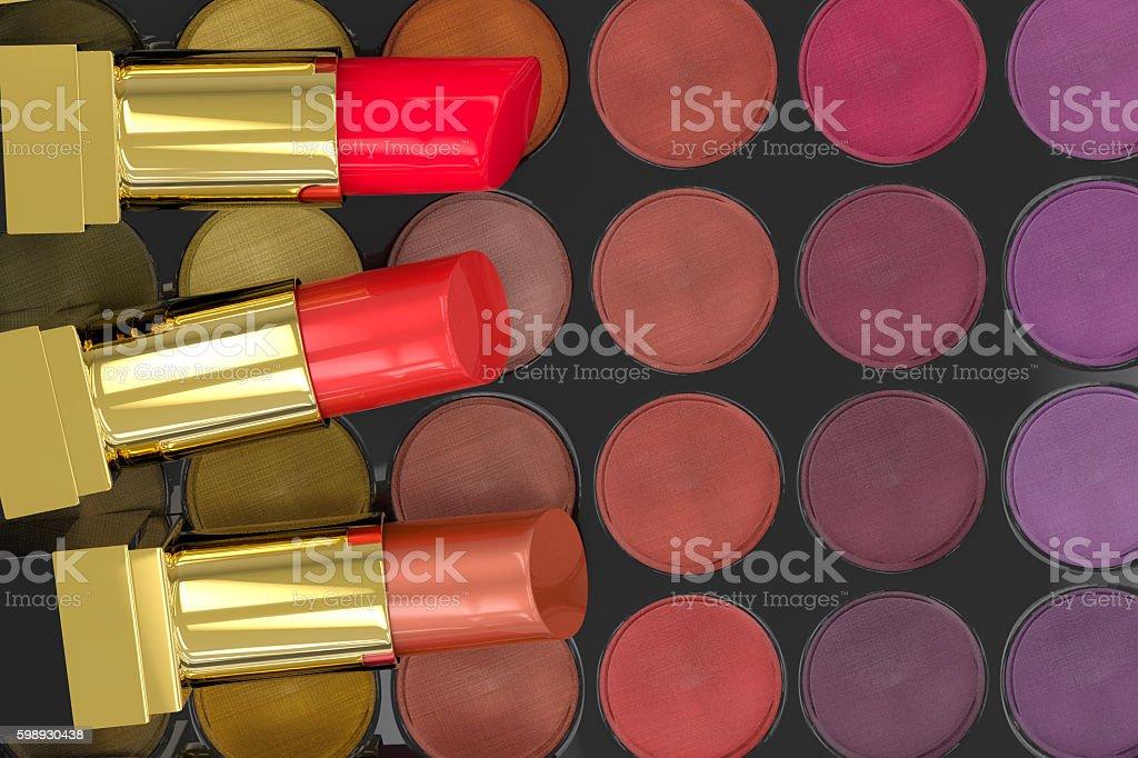 lipsticks on eye shadow palette stock photo