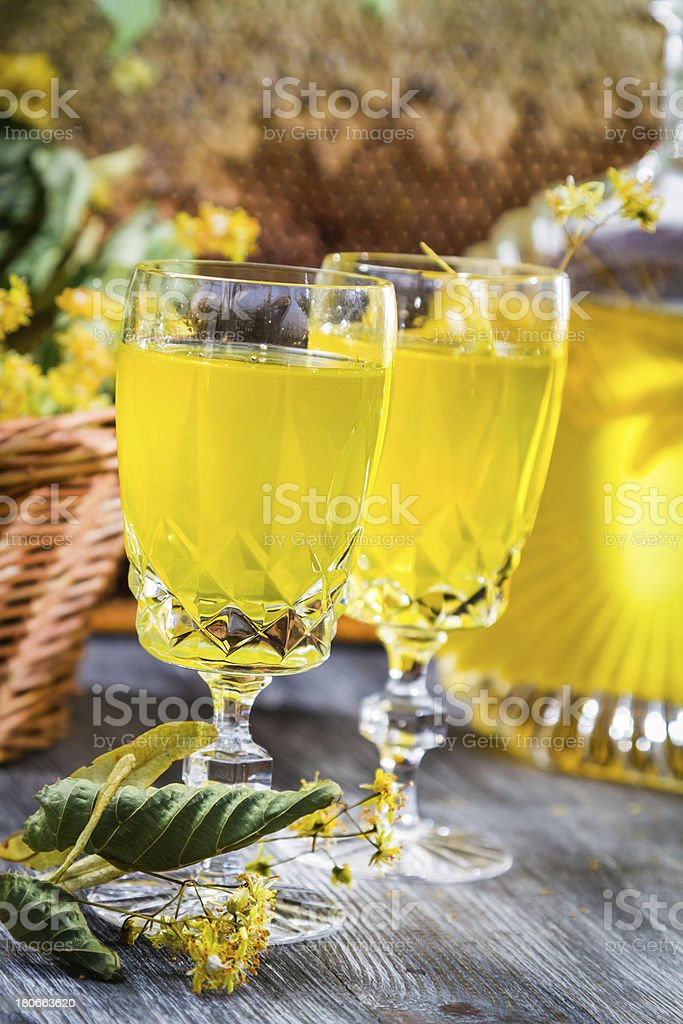 Liqueur in glass made of honey and lime royalty-free stock photo
