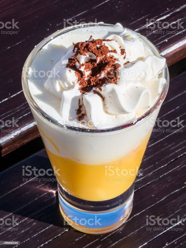 liqueur with whipped cream and cocoa powder, eggnog stock photo