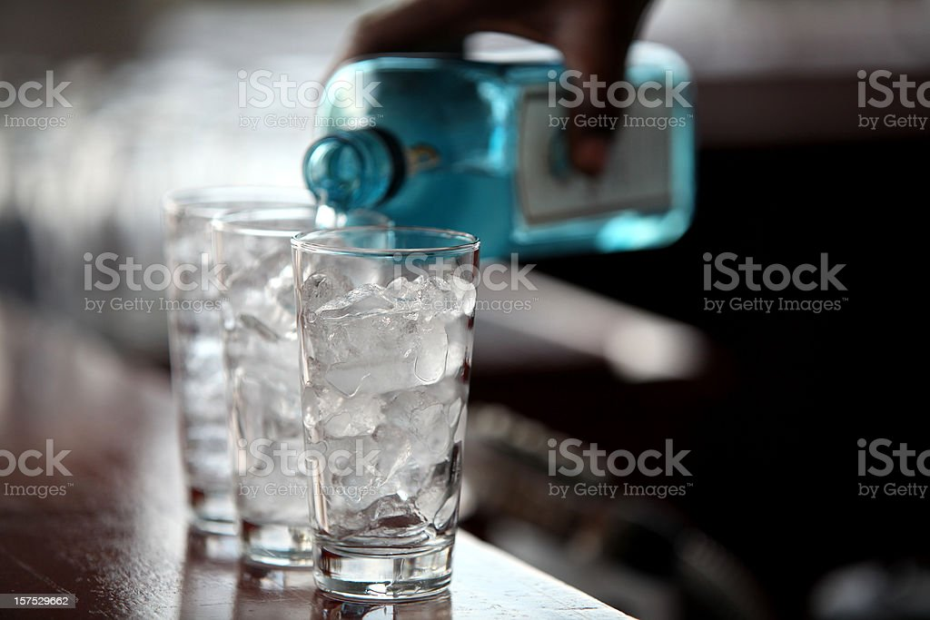 Liquid and ice cubes stock photo