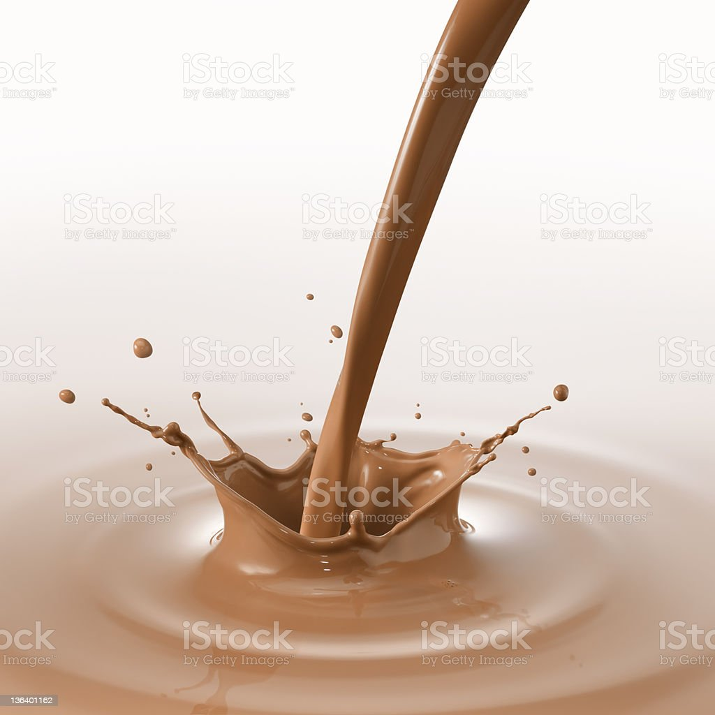 A liquid chocolate being poured royalty-free stock photo