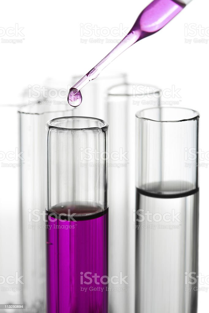 liquid dripping from pipette into test tube isolated stock photo