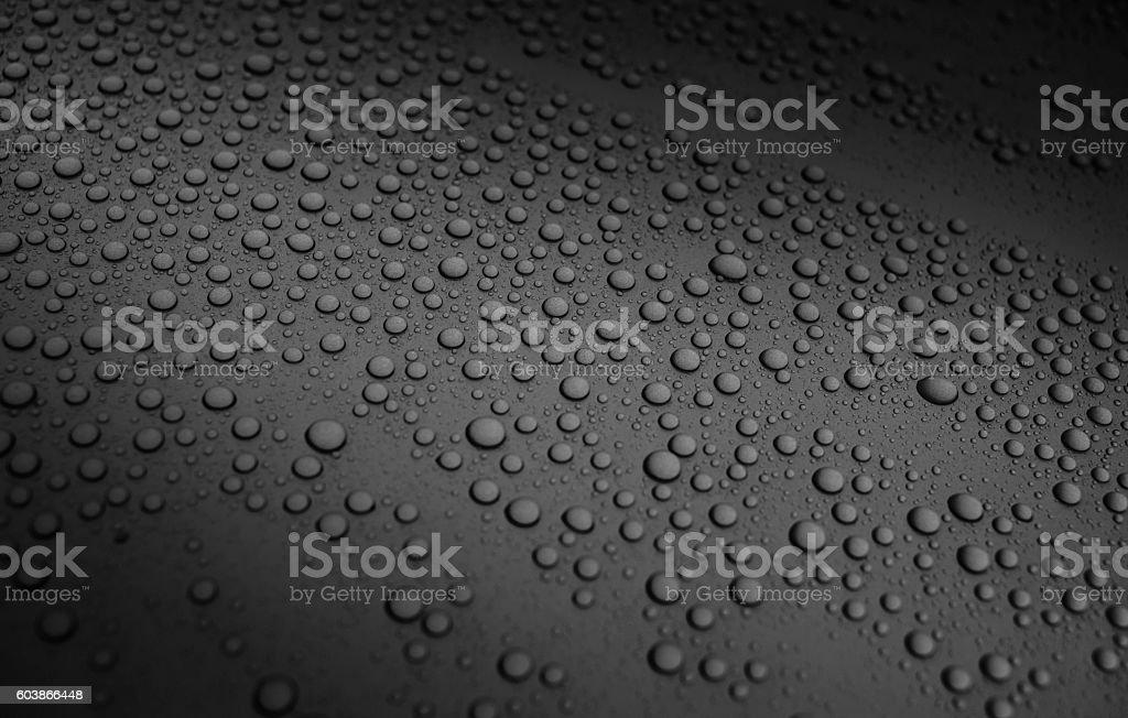 liquid drops of water on metallic surface stock photo