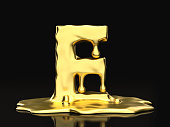 Liquid gold letter E