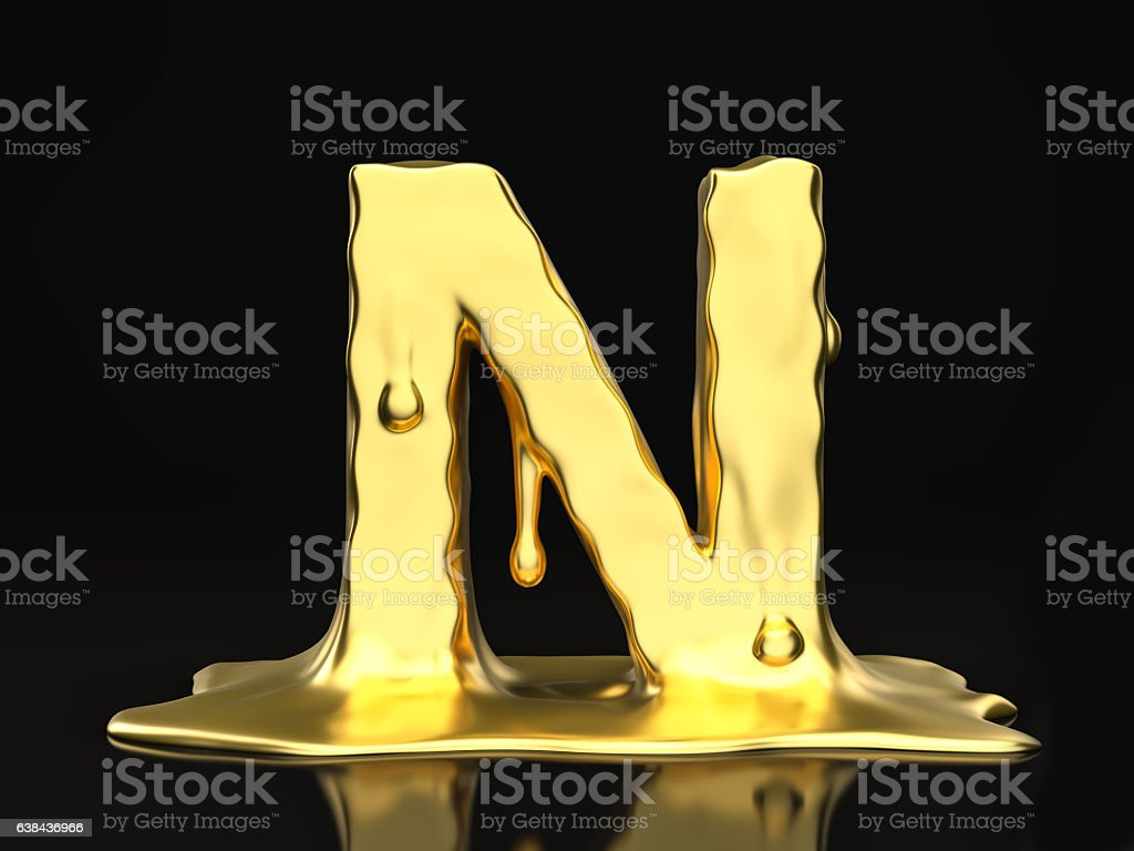 Liquid gold letter N stock photo