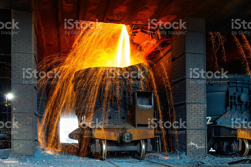 Liquid iron from ladle in the steelworks stock photo