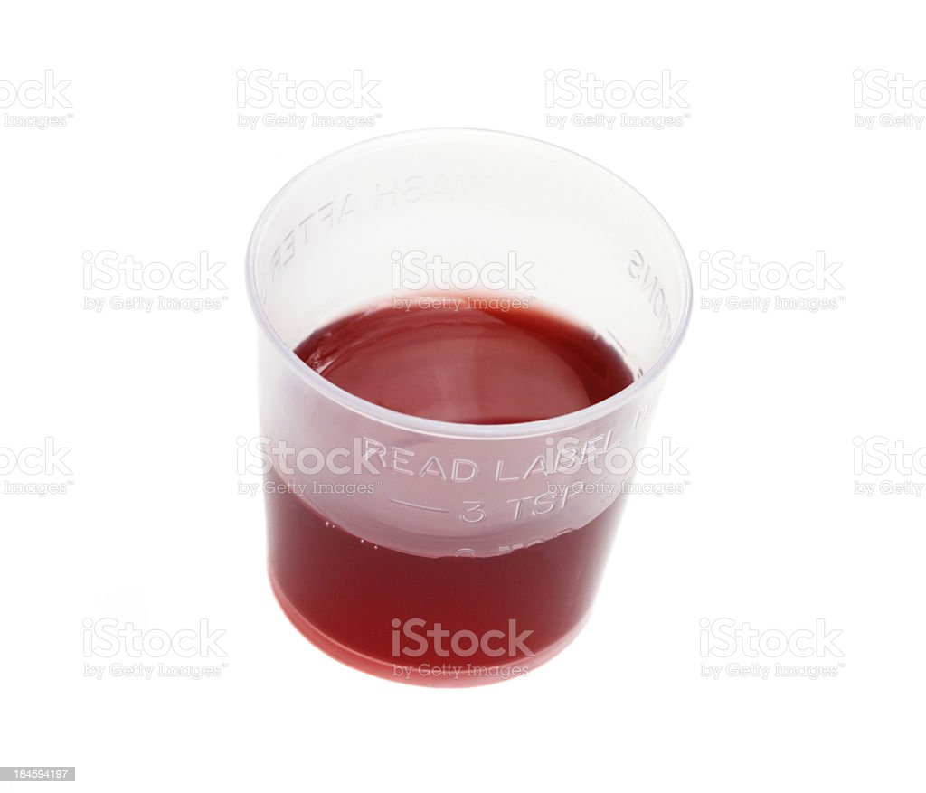 Liquid medication in measuring cup royalty-free stock photo