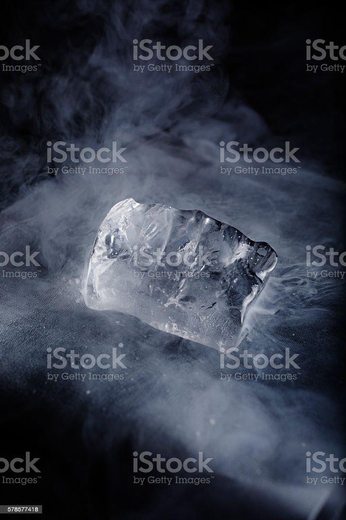 Liquid nitrogen spilled ice cube stock photo