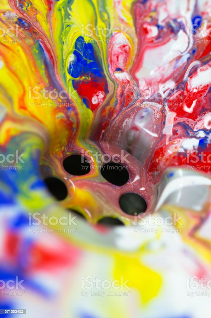 Liquid paint flow in to the water drain stock photo