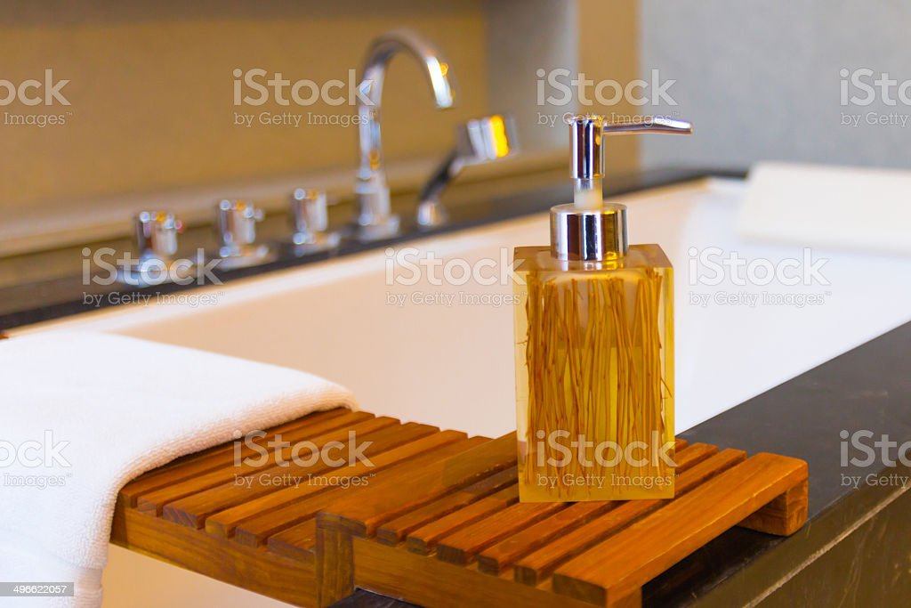 Liquid soap bottle on the bathtub in modern bathroom stock photo