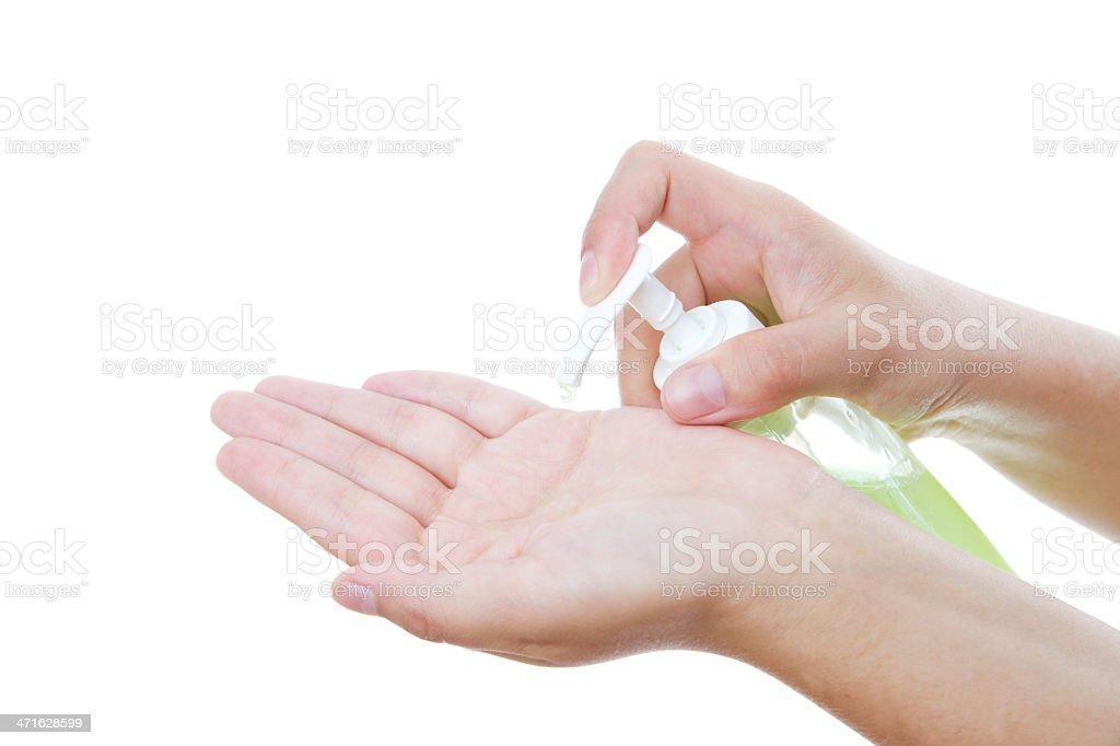 Liquid soap in female hands stock photo