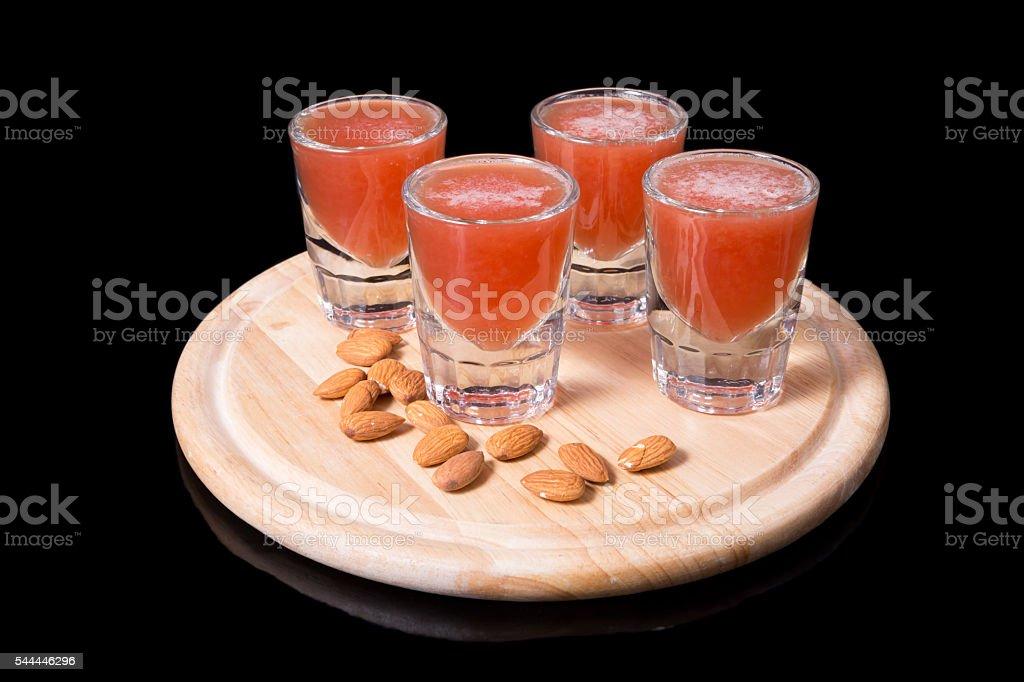 Liquor shots with almonds stock photo
