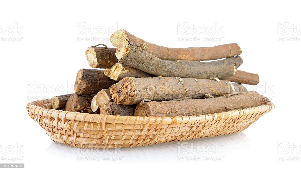 Liquorice roots in basket on white background stock photo