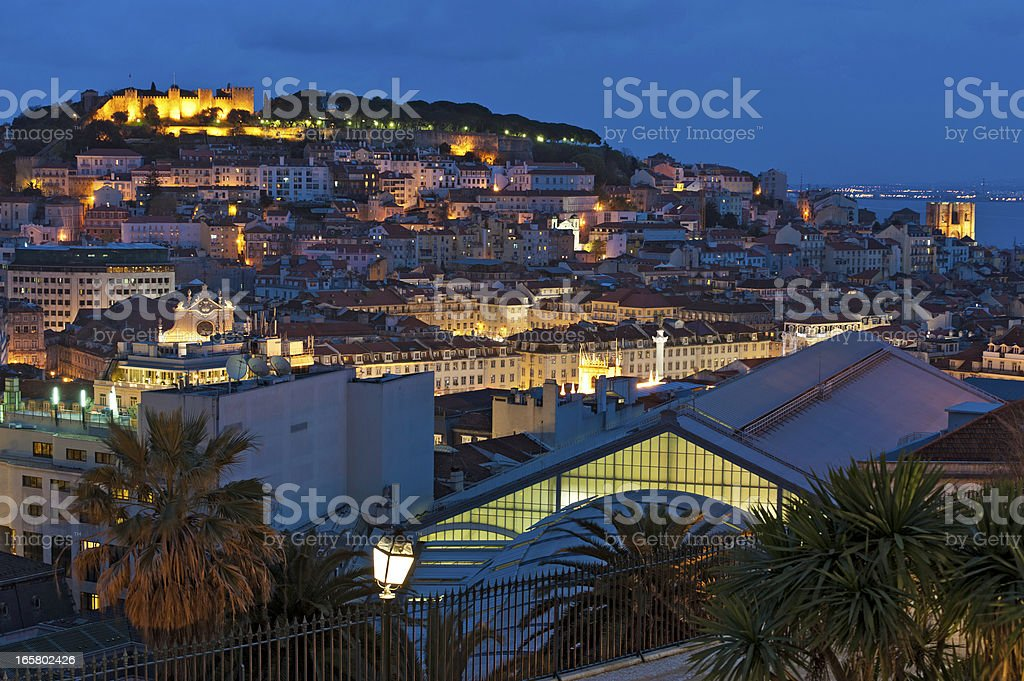 Lisbon night lights landmarks Castelo Sao Jorge Baixa rooftops Portugal royalty-free stock photo