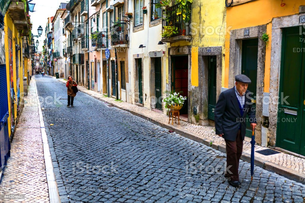Lisbon, Portugal - 05 06 2016: People walking on a narrow street of Lisbon in Bairro Alto district stock photo